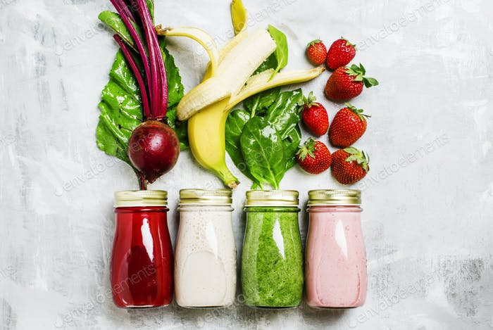 Multicolored juices and smoothies of fresh vegetables, fruits and berries