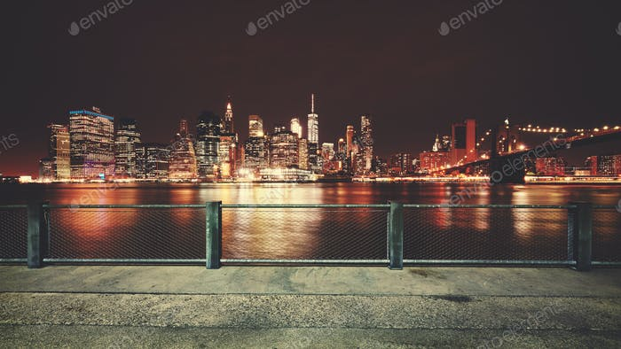 Promenade with view of Manhattan skyline at night, New York.