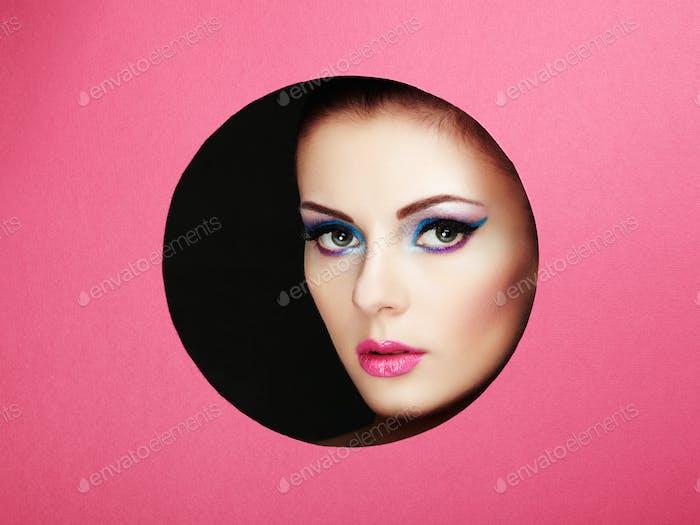 Conceptual beauty portrait of beautiful young woman