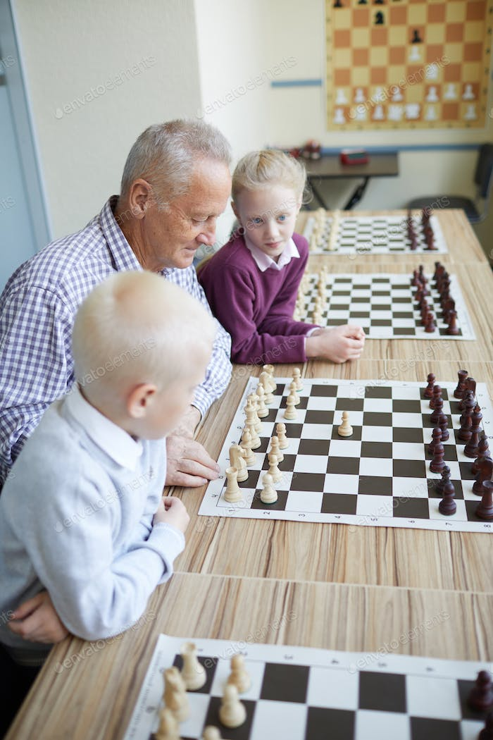 Grandfather showing chess combination