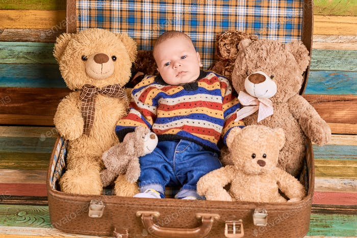 Child and teddy bears