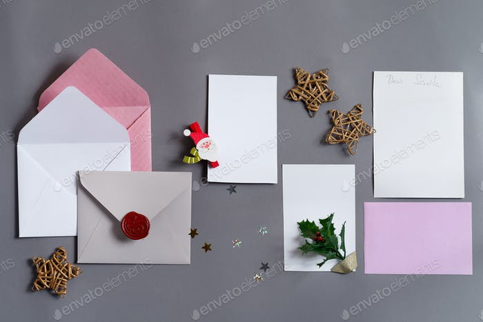 Christmas mockup cards with envelopes and holiday decoration