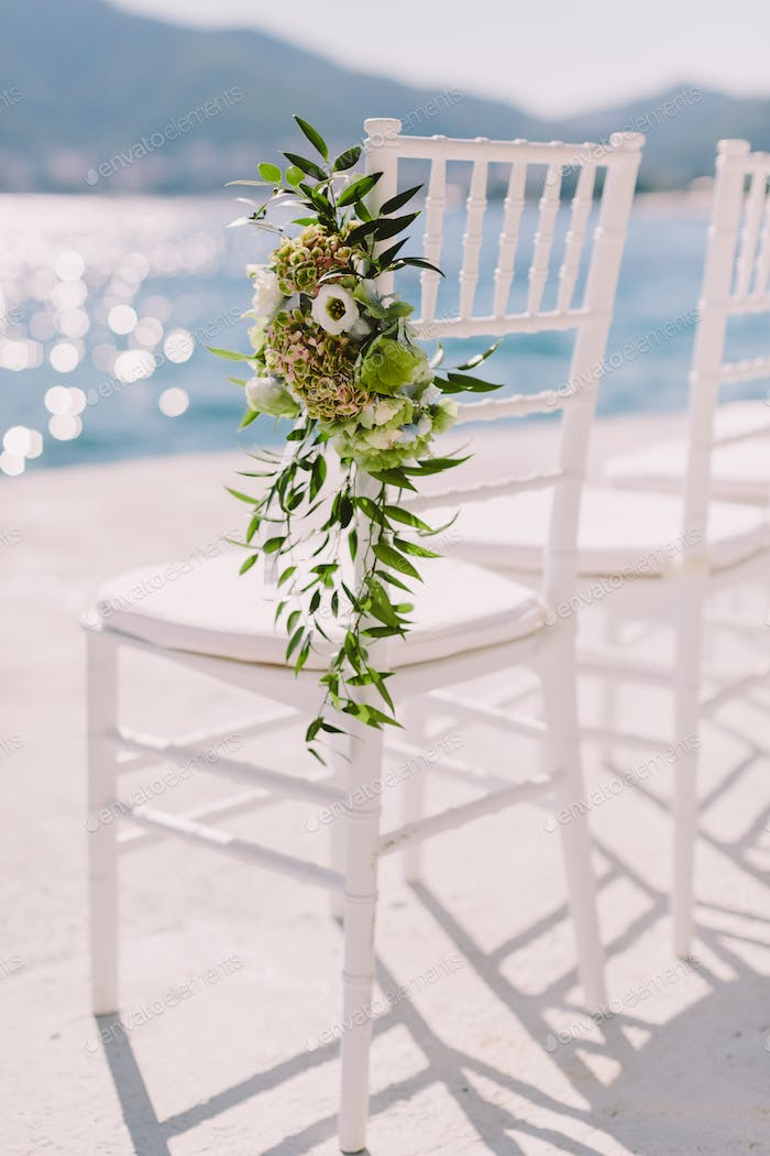 white wedding chairs outdoors venue