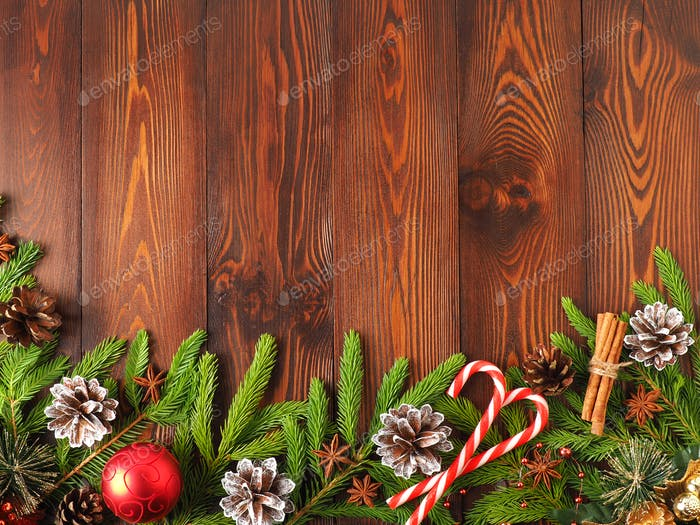 Christmas and Happy New Year dark brown background. Top view, copy space, wooden rustic table
