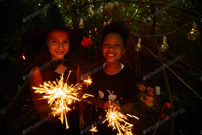 Kids with sparklers at party