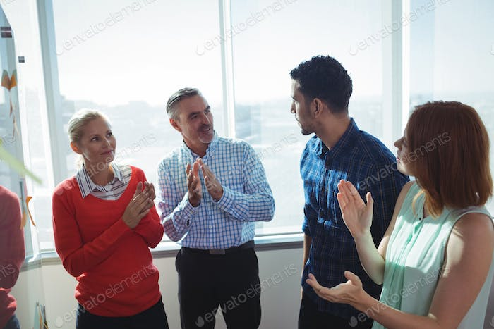Business entrepreneurs discussing by window at office