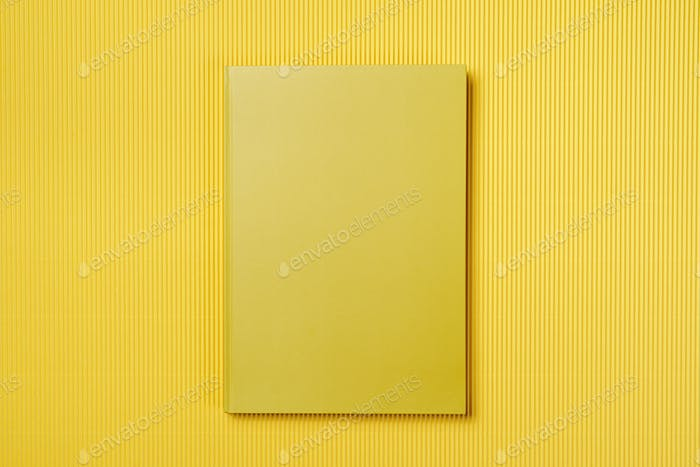 Yellow leather notebook on a yellow background