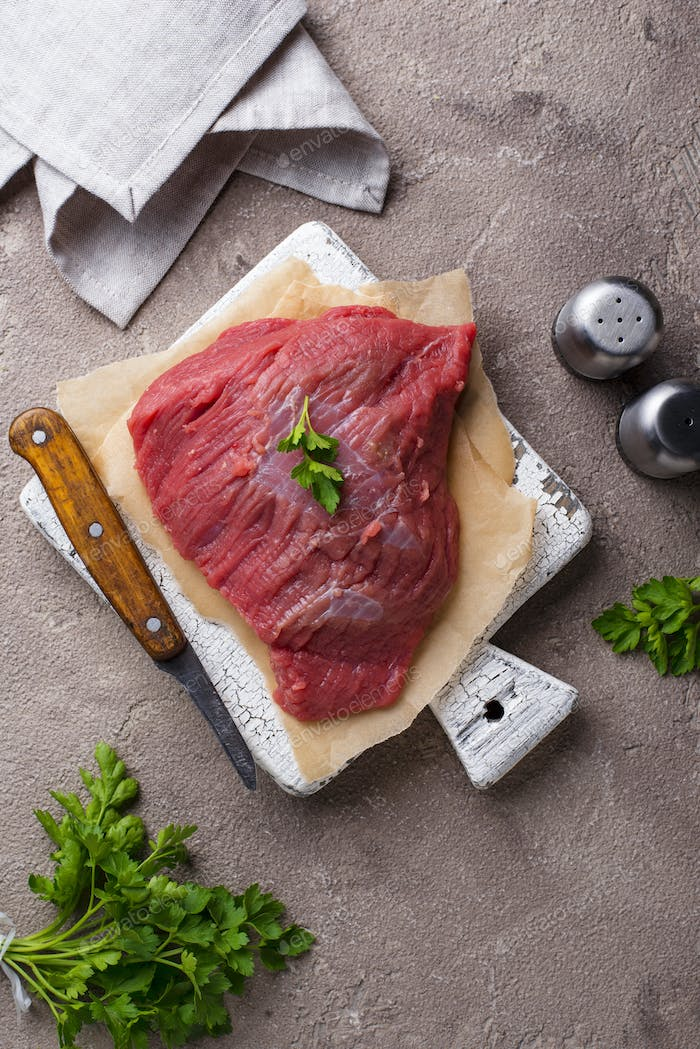Raw meat on cutting board