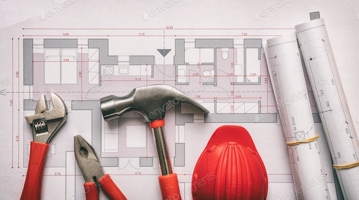 Tools and hardhat on project drawings. Architect engineer office desk.