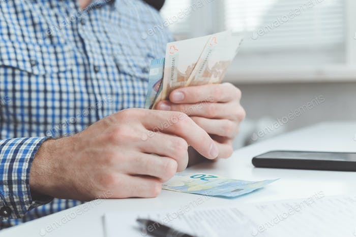 Businessman calculates the costs incurred or salary