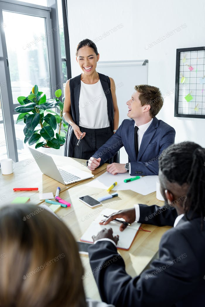 multiethnic happy business coworkers during meeting in office