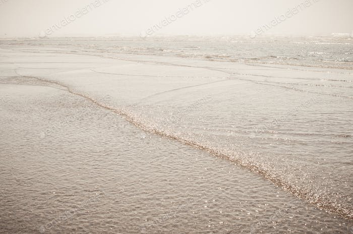 Rippling waves on the shore