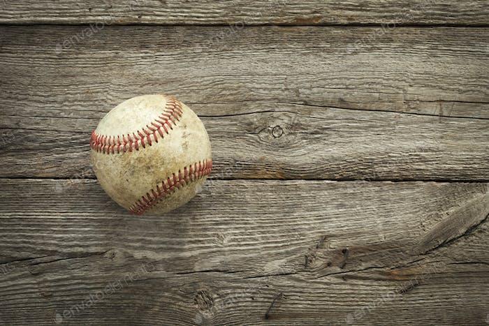 Old Baseball on Rough Wood
