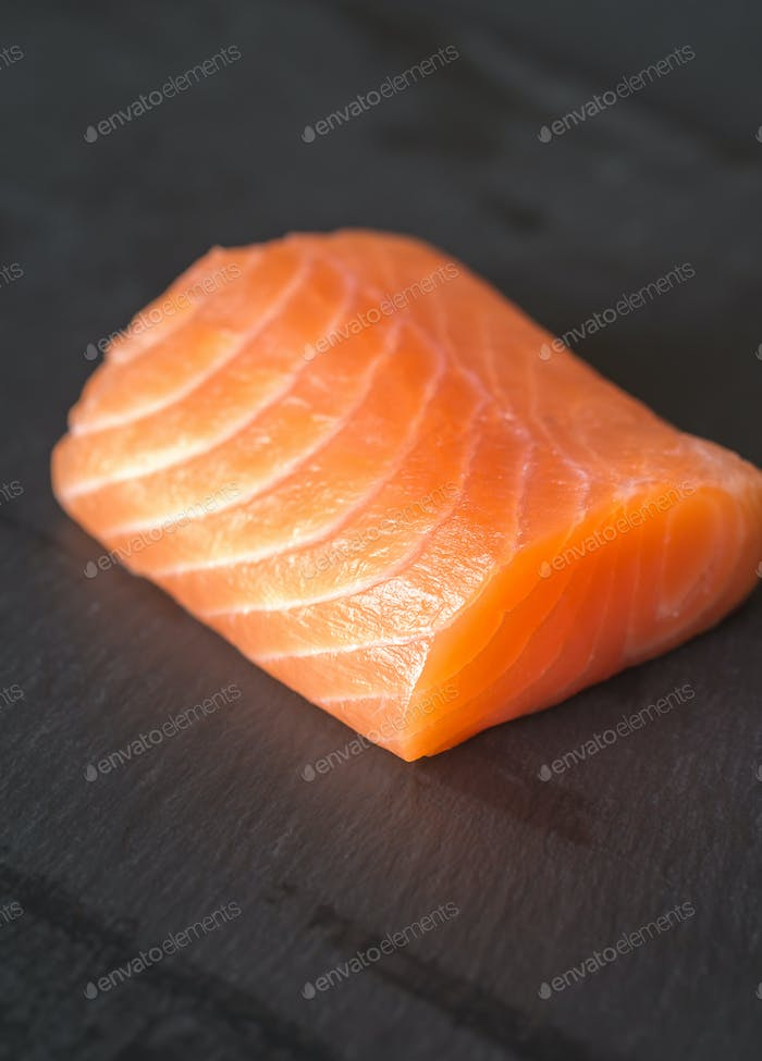 Salmon on the black stone board