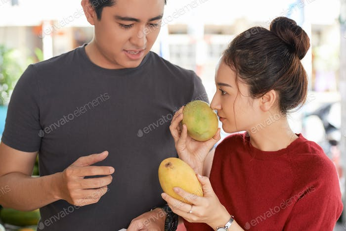 Couple choosing mango