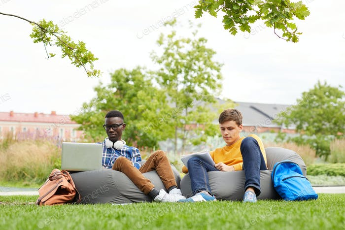 Students Relaxing Outdoors on Campus