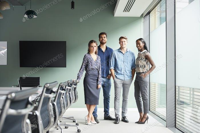 Portrait Of Casually Dressed Businessmen And Businesswomen Having Informal Meeting