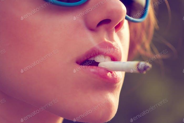 woman smoke a cigarette