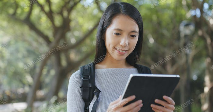 Woman use of tablet computer at outdoor