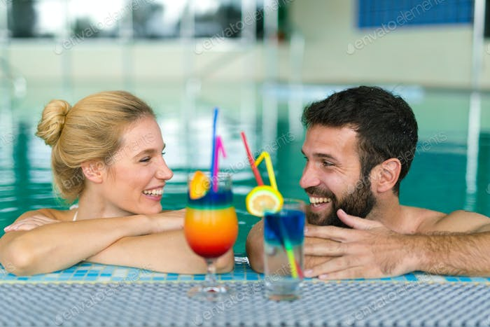 Happy couple relaxing at wellness spa center
