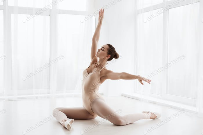 Graceful Ballet Girl Posing In Modern Dance Studio