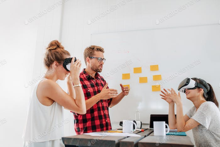 Developers brainstorming on augmented reality technology devices