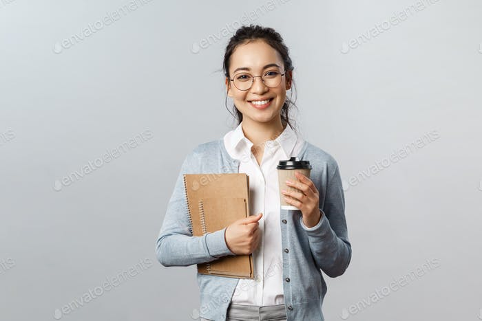 Education, teachers, university and schools concept. Good-looking smiling asian tutor, female with