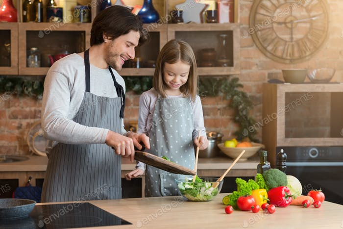 Family Cooking. Cheerful Dad And Little Daughter Preparing Healthy Lunch Together