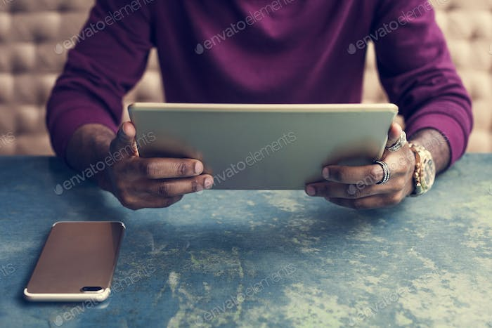 African man using digital tablet