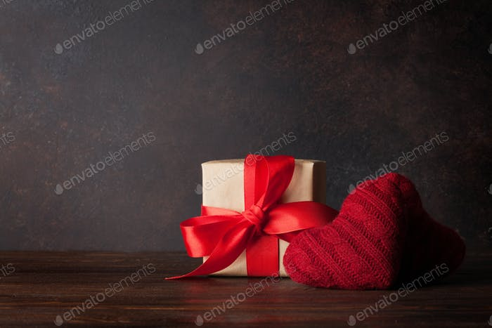 Valentines day greeting card with red hearts and gift