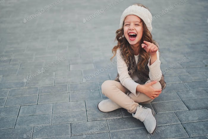 cute little girl with knitted hat