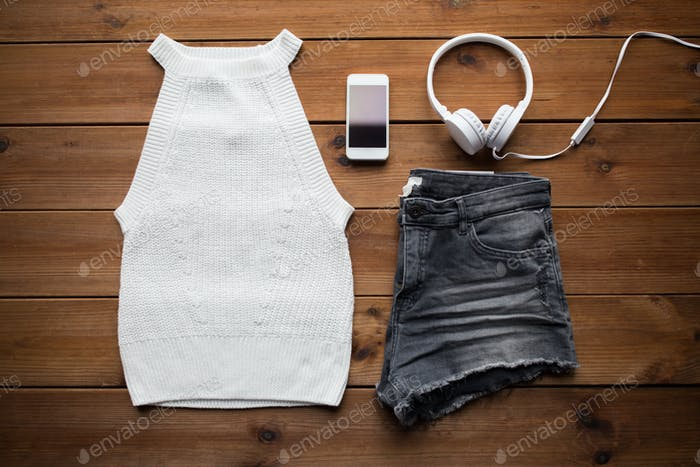 clothes and smartphone with headphones