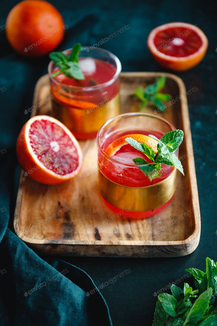 Refreshing cold summer cocktail with blood orange and mint.
