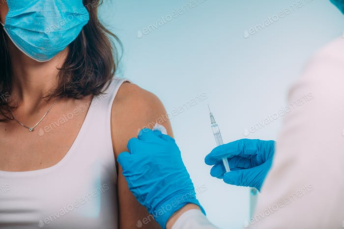 Medical Professional Administering a Vaccine. Corona Virus Vaccination.