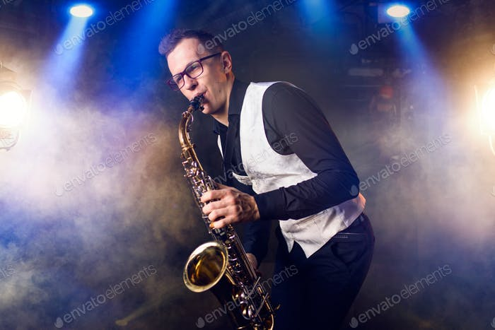 Male saxophonist playing classical music on sax