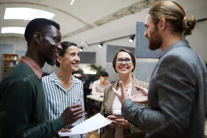 Business People Laughing at Coffee Break