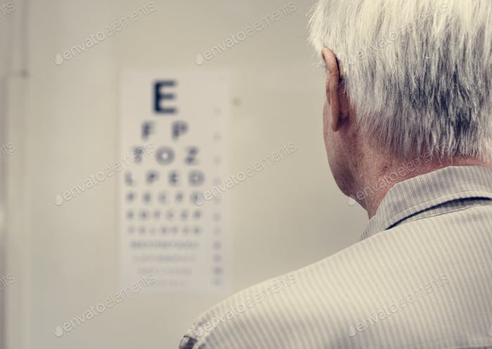 An elderly patient is having sight testing