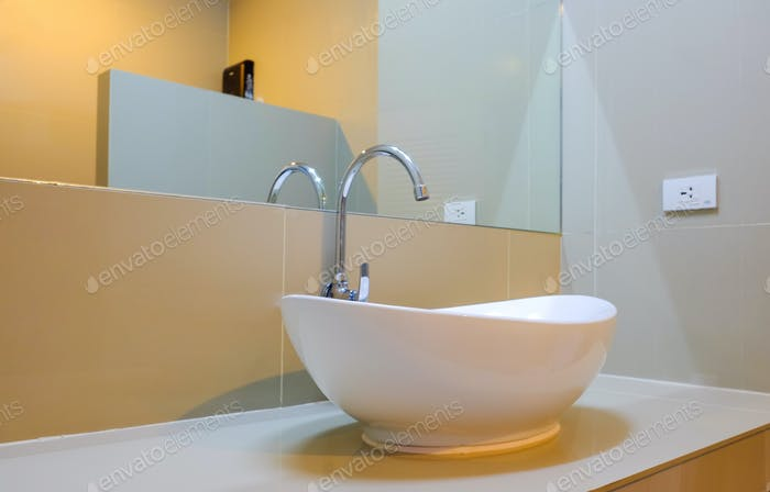 Large white sink with glass in the bathroom.