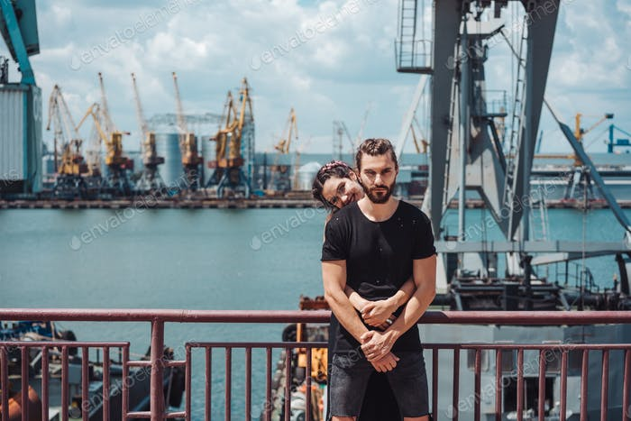 Guy and girl in the docks