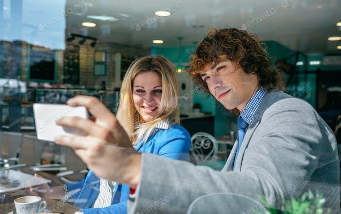 Coworkers taking a selfie
