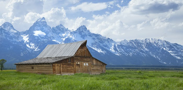 Barn in Field Below Grand Teton Mountains