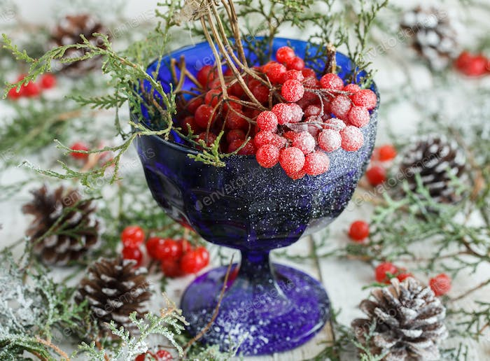 Natural Christmas ornaments in the bowl with cranberries.