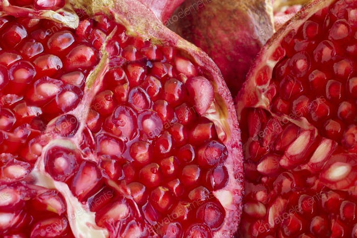 Pomegranate fruit seeds macro detail. Healthy food. Horizontal