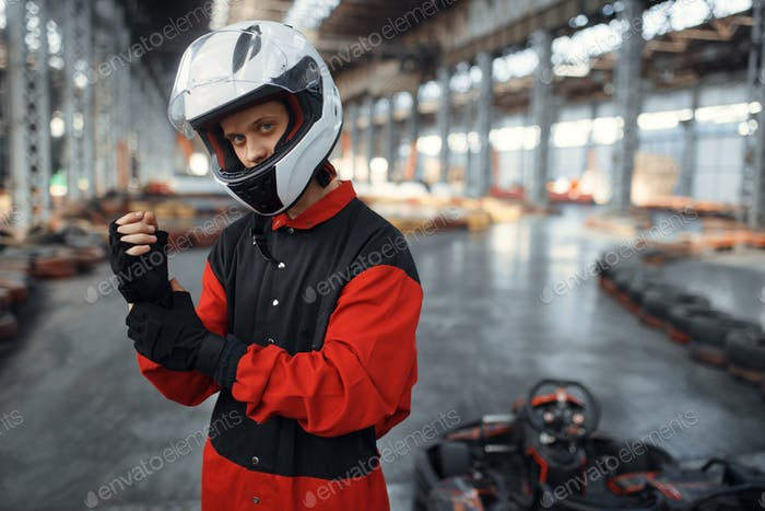 Kart racer in red uniform, helmet and gloves