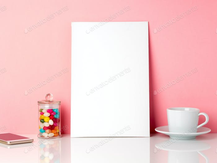Blank white frame and candys in jar, cup