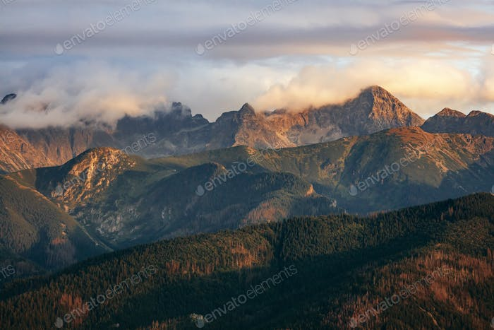 Mountain peaks in clouds at sunset. Tatra Mountains, Poland