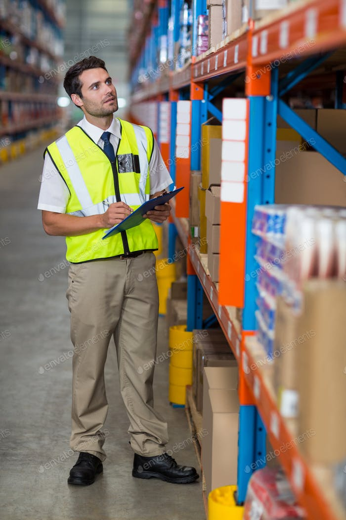 Warehouse manager looking at packages
