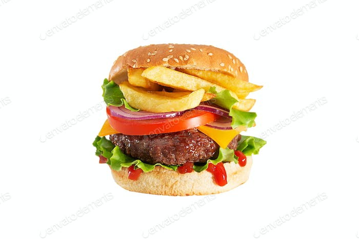 Fresh juicy beef hamburger with dripping ketchup and french fries on white background