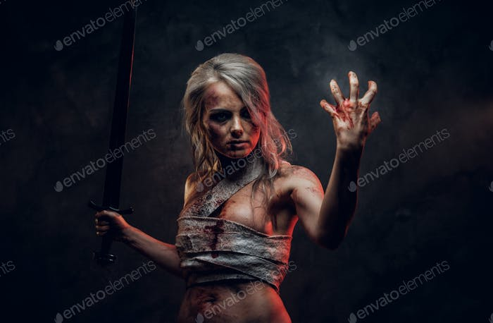 Naked Fantasy woman warrior wearing rag cloth stained with blood and mud in the heat of battle