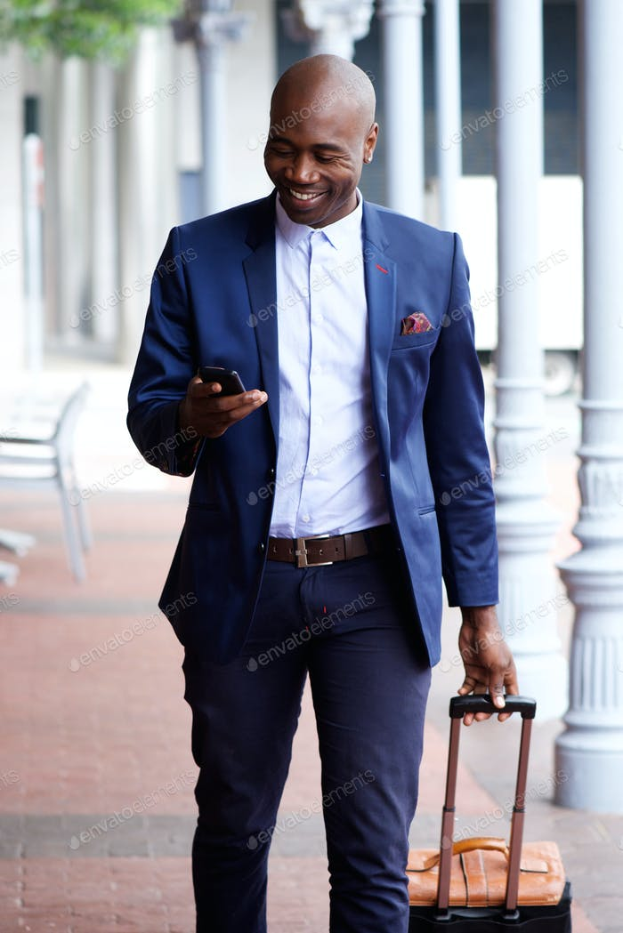 African business man traveling with bag and cell phone